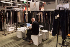 Exhibitor in his stand at Mipap trade show in Milan, Italy Stock Photo