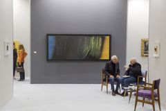 Exhibitors at Miart 2018 in Milan, Italy. MILAN, ITALY - APRIL 13: Exhibitors are seen in their stand at Miart, international exhibition of modern and Stock Photo