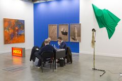 Exhibitors at Miart 2018 in Milan, Italy. MILAN, ITALY - APRIL 13: Exhibitors are seen in their stand at Miart, international exhibition of modern and Stock Photography
