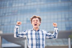 Exhilarate. Young happy man exhilarating outdoors Royalty Free Stock Photo