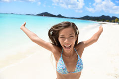 Exhilarated Female Tourist Screaming On Beach. Exhilarated young woman screaming on beach. Portrait of cheerful female in bikini enjoying her summer vacation Royalty Free Stock Photos