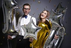 Couple celebrating New Year`s Eve. Exhilarated friends welcoming new year Stock Photo