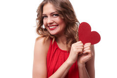 Exhilarated woman holding a valentine greeting card in hands. Close-up of exhilarated woman holding a valentine greeting card in hands isolated over white Stock Images