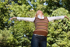 Exhilarated woman outdoors Royalty Free Stock Image