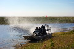 An exhilarating boat ride in florida. People having fun on an air boat in the everglades royalty free stock images