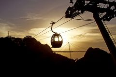 Skycab - Langkawi. The exhilarating 15 minute cable car ride is 2150 metres long and climbs 680 metres, with magnificent views high above the treetops of dense stock image