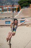 Exhilaration of riding the zip line. Female pre teen riding the zip line at the beach royalty free stock photography