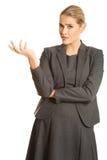 A exibição confusa da mulher irrita o gesto Fotos de Stock Royalty Free