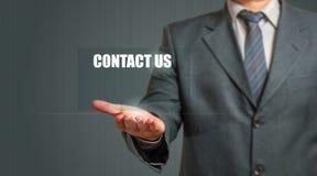 A exibição do homem de negócio contacta-nos sinal Imagem de Stock Royalty Free