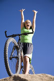Exicited woman on bike Royalty Free Stock Photos