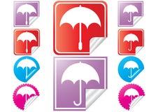 Existencia-vector-brillante-paraguas-etiquetas engomadas Fotos de archivo libres de regalías