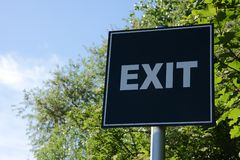 Exit. \EXIT\ sign against blue sky Stock Photo