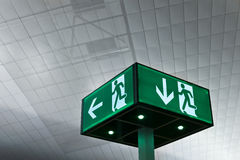 Exit. Luminous exit sign in modern building Royalty Free Stock Image