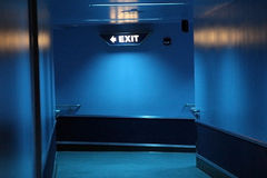 Exit. Blue exit corridor at night royalty free stock photos