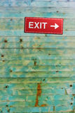 Exit. Sign on a wooden wall Stock Photography