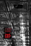 Exit. Red Exit sign on shiny ceiling royalty free stock images
