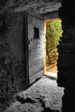 Exit. Old door in an acient castle in France Stock Photography