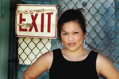 Exit. Woman at exit sign with fence Stock Photos