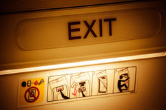 Exit in airplane royalty free stock photos