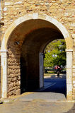 Exit arch through the surrounding wall out of Faro old town. In Portugal Stock Photo