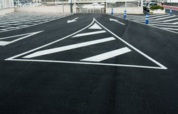 Exit and entrance from a town-centre car park with arrow painted. In the road Stock Photography