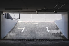Exit entrance of underground car parking with arrows road sign Royalty Free Stock Photos