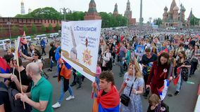 Exit from the event. RUSSIA, MOSCOW - MAY 9, 2019: Exit from the event. Procession Immortal Regiment - a civil initiative to perpetuate the feat of soldiers of stock video
