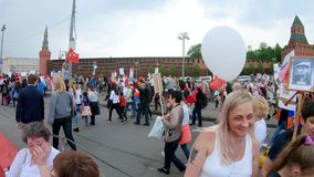 Exit from the event. Russia, Moscow - May 9, 2019: Exit from the event. Procession Immortal Regiment - a civil initiative to perpetuate the feat of soldiers of stock footage