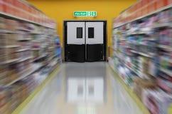 Exit fire doors in supermarket. Focus on the Exit fire doors in supermarket Royalty Free Stock Photo