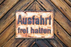 EXIT free GermanSign on Timber Wall Background Stock Photo