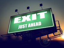 Exit Just Ahead on Green Billboard. Stock Photography