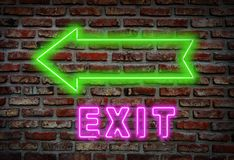 Exit neon sign on wall royalty free stock photo