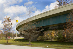 Exit Ramp. Off Interstate 4 in Orlando, Florida. Image is shot from beneath the bridge and shows the supports, blue sky and the landscaping that is typical of royalty free stock image