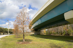 Exit Ramp. Off Interstate 4 in Orlando, Florida. Image is shot from beneath the bridge and shows the supports, blue sky and the landscaping that is typical of royalty free stock images