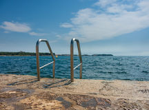 Exit from sea. Stainless ladder exit from sea royalty free stock image
