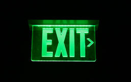 Exit Sign. Neon Green Exit Sign set on black royalty free stock image
