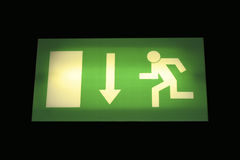 Exit sign. Illuminated green emergency exit sign royalty free stock photo