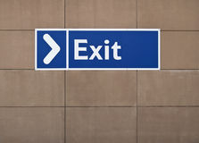 Exit sign. Blue exit sign on the wall with arrow Stock Images