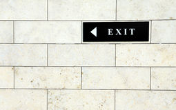 Exit sign. Black exit sign on the white wall Stock Image