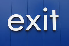 Exit Sign. Lower case exit sign against a blue background Royalty Free Stock Images
