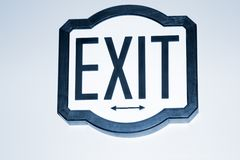 Exit Sign. On wall with arrows to left and right Royalty Free Stock Images