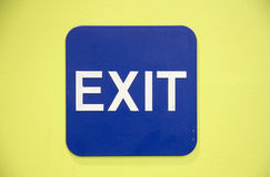 Exit sign. With blue and yellow background Stock Image