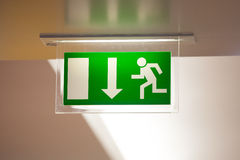 Exit sign. Emergency exit sign with a arrow pointing down Stock Image