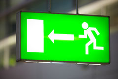Exit sign. Emergency exit sign with a arrow pointing to the left Stock Image