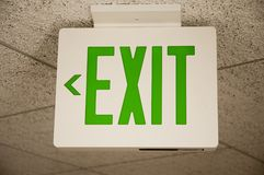 Exit sign. Ceiling mounted exit sign with green print Stock Images