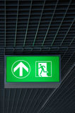 Exit sign. Illuminated sign guides to an emergency exit Royalty Free Stock Photos