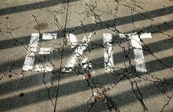 Exit sign. In cracked pavement Stock Images