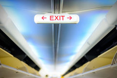 Exit sign in an aircraft interior Stock Image