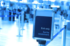 Exit sign in an airport Royalty Free Stock Image