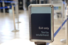 Exit sign in an airport Stock Photos